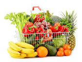 Wire shopping basket with groceries isolated on white — Stock Photo