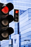 Traffic lights over modern business architecture — Stock Photo