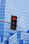 Traffic lights over modern business architecture — 图库照片