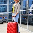 Young woman with luggage at the airport. Traveling tourist — Stock Photo #46545083