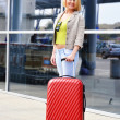 Young woman with luggage at the airport. Traveling tourist — Stock Photo #46545093