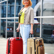 Young woman with luggage at the airport. Traveling tourist — Stock Photo #46545105