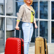 Young woman with luggage at the airport. Traveling tourist — Stock Photo #46545117