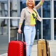 Young woman with luggage at the airport. Traveling tourist — Stock Photo #46545129