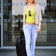 Young woman with luggage at the airport. Traveling tourist — Stock Photo