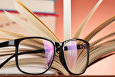 Composition with glasses and books on the table — 图库照片
