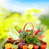 Wicker basket with groceries — Stock Photo