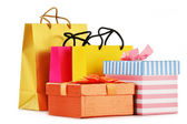 Gift boxes and colorful gift bags isolated on white — Zdjęcie stockowe