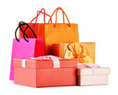 Gift boxes and colorful gift bags isolated on white — ストック写真