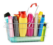 Wire shopping basket with body care and beauty products — Stock Photo