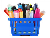 Plastic shopping basket with body care and beauty products — Stock Photo