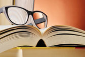 Composition with glasses and books on the table — Foto Stock