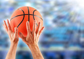 Hands catching basketball — Stock Photo