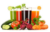 Glasses with fresh vegetable juices isolated on white — Stock Photo