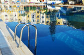 Swimming pool in touristic resort during summer time — Foto de Stock