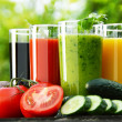 Glasses with fresh vegetable juices in the garden. Detox diet — Stock Photo #50009997
