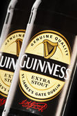 Bottles of Guiness beer — Stock Photo