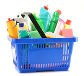 Shopping basket with detergent bottles isolated on white — Stock Photo