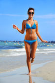 Young woman on the mediterranean beach — Stock Photo