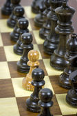 White pawn on black rows — Stock Photo