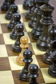 White pawn on black rows — Stock Photo