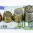 Close-up of Euro banknotes and coins — Stock Photo