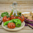 Still life with olive oil,vegetables on wood table — Stock Photo