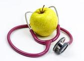 Stetoscopio e una mela — Foto Stock