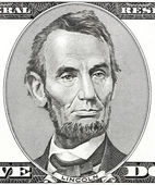President Abraham Lincoln as he looks on five dollar bill obverse — Stock Photo