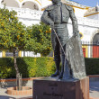 Matador Curro Romero statue in Seville — Stock Photo #37151433