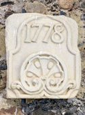 Stone slab engraved with the year 1778. In the monastery of Poblet — Stock Photo
