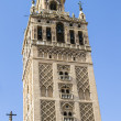 Giralda tower, the belfry of the Cathedral of Sevilla — Stock Photo