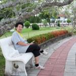 Asian senior woman sitting on chair — Stock Photo #11369488