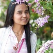 Asian woman portrait with orchid flower — Stock Photo