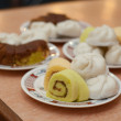 Stock Photo: Yam roll and cake on dish on table