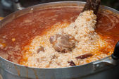 Rice with buried goat meat cooking in pot - islamic food — Stock Photo
