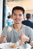 Asian man enjoy eating breakfast — Stock Photo
