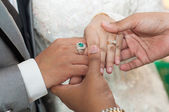 Holding asian wedding lovers hands with diamond rings — Stock Photo