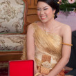 Stock Photo: Asithai bride in thai wedding suit smiling in wedding ceremon
