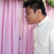 Asian thai bridegroom in thai wedding suit at wedding ceremony - Стоковая фотография