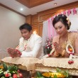 Praying asian thai wedding ceremony bride and bridegroom - Stock Photo