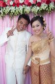 Asian thai couple bride and bridegroom in thai wedding suit at w — Stock Photo