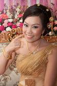 Asian thai bride in thai wedding suit smiling in wedding ceremon — Stock Photo