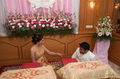 Bride and bridegroom tired and sit down in wedding ceremony — Stock Photo