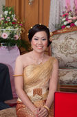 Asian thai bride in thai wedding suit smiling in wedding ceremon — Stock Photo