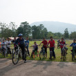 YALA, THAILAND - APRIL 1: Unidentified mountain bikers wait for - Stock Photo