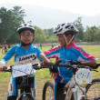YALA, THAILAND - APRIL 1: Unidentified boys wait on mountain bik - Stock Photo