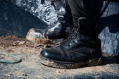 Dirty boots from mud — Stock Photo