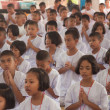 Stock Photo: YALA, THAILAND - AUGUST 15:Youg Buddhism students pray in Buddhi