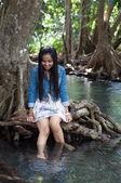 Asian woman portrait in beautiful nature scene — Stock Photo